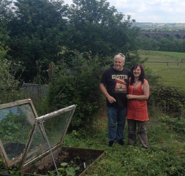 Phil and Helen showing off their view over Reddish Vale